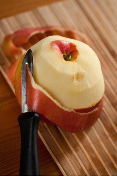 peeling apples for cinnamon applesauce