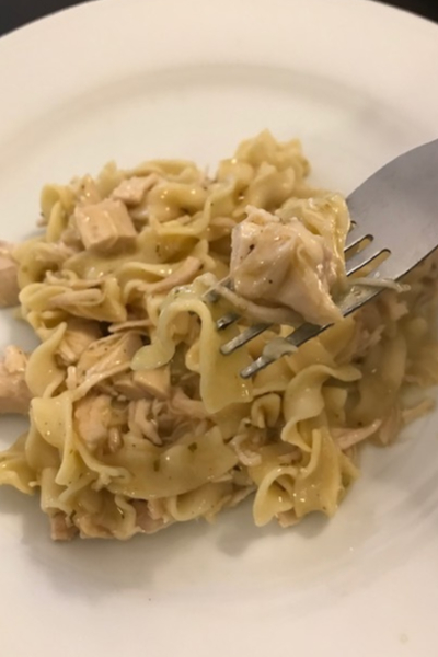 bite of slow cooker chicken and noodles