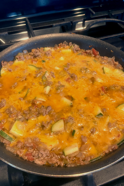 cheddar cheese on zucchini ground beef skillet