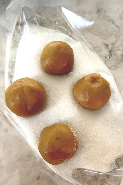 dough balls in sugar